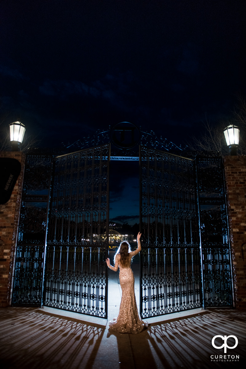 Bride at the gates of the wedding venue.