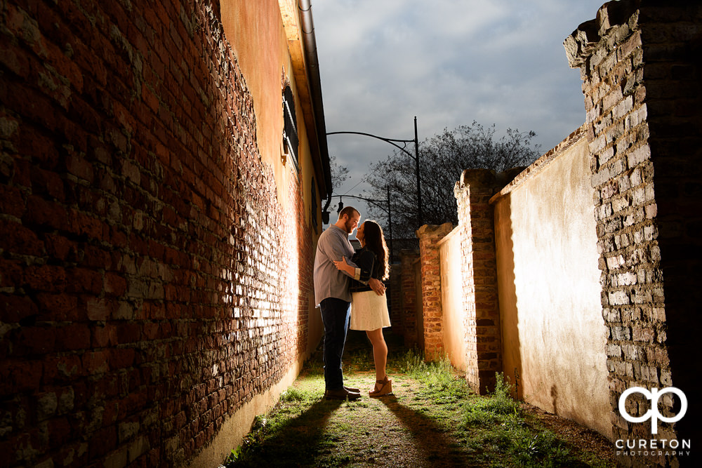 Man hugging his fiancee during a n engagement session in Greenville,SC.