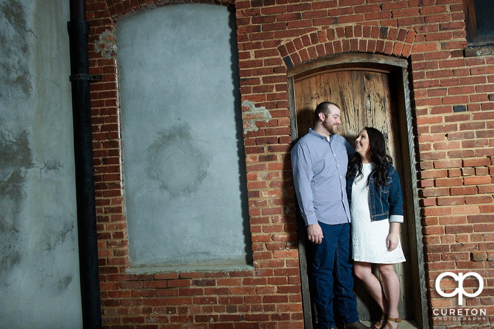 Couple looking at other during an engagement session.