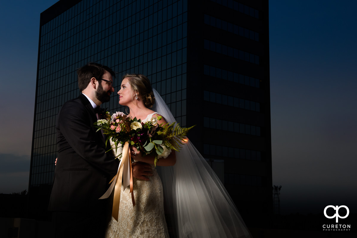 Bride and groom on a rooftop at The Commerce Club.