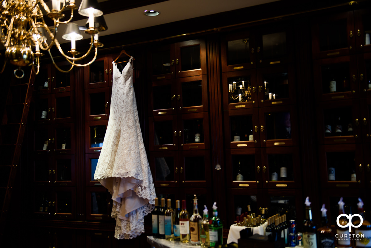 Bride's dress hanging in the wine room at the Commerce Club.