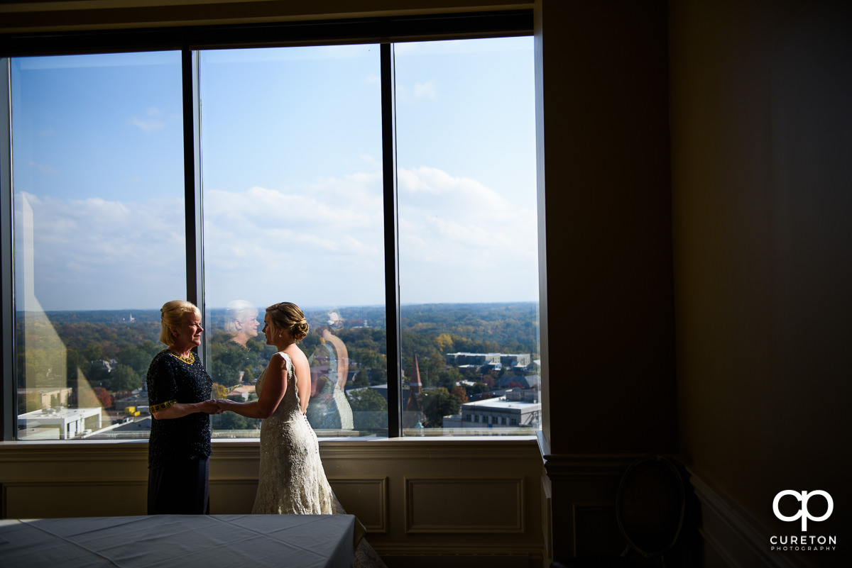 Bride and her mother share a moment 17 floors up at The Commerce Club before the wedding ceremony.