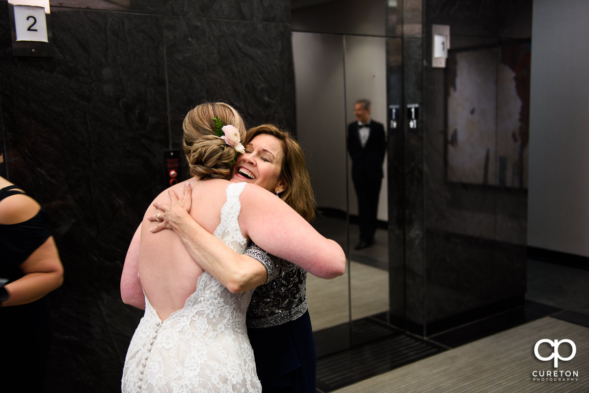 Bride hugging her future mother in law.