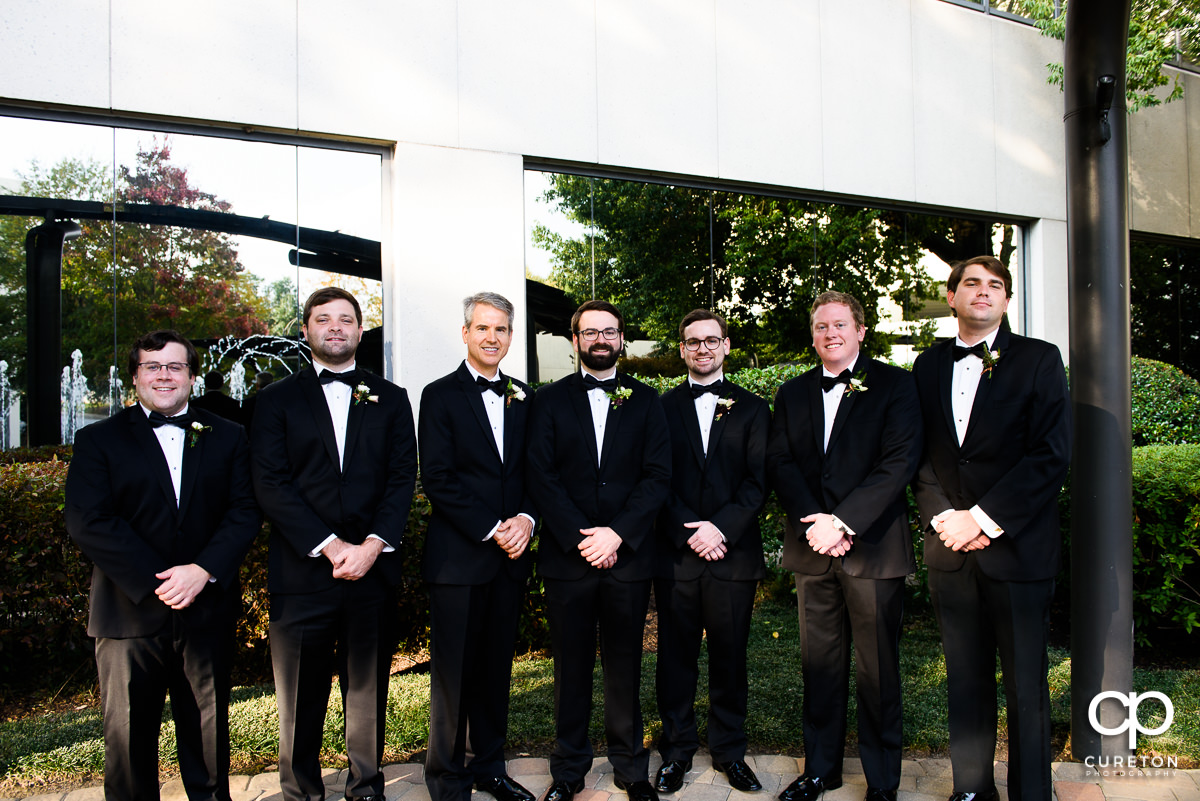Groom and groomsmen in front of the Commerce Club.