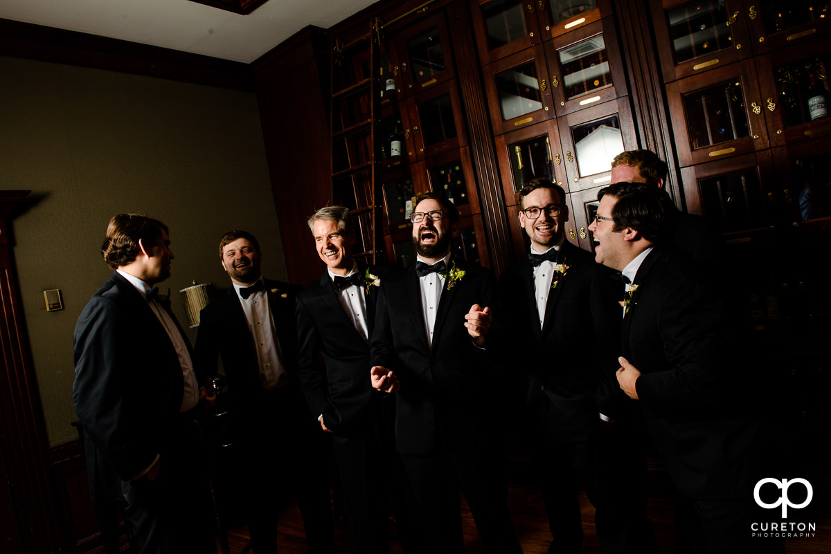Groomsmen in the wine room at the Commerce Club.
