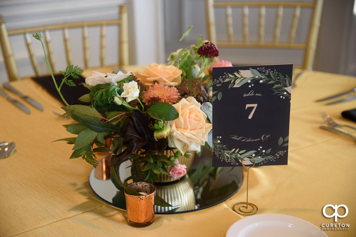 Floral centerpieces by Statice.