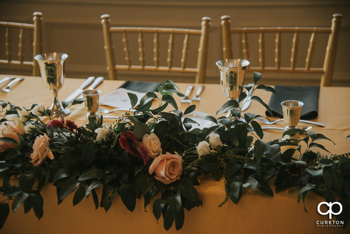 Florals on the wedding party table.