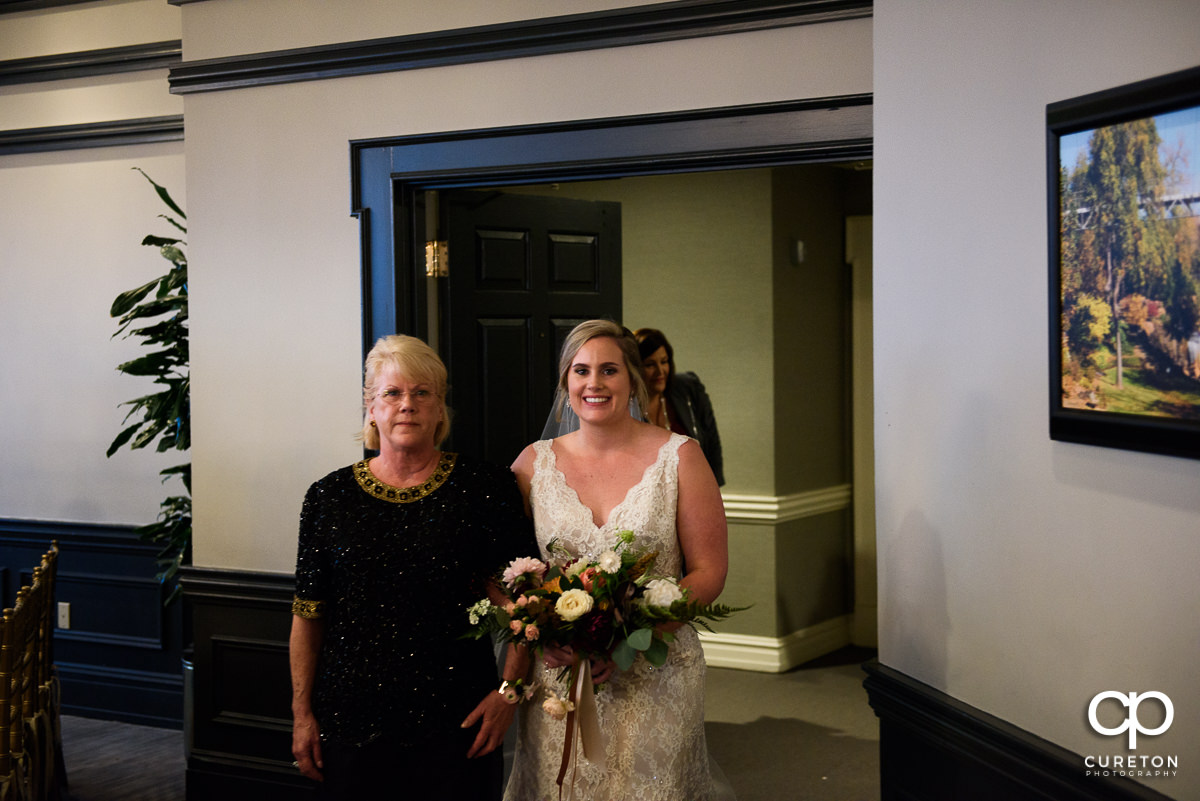 Bride and her mom entering the wedding ceremony.