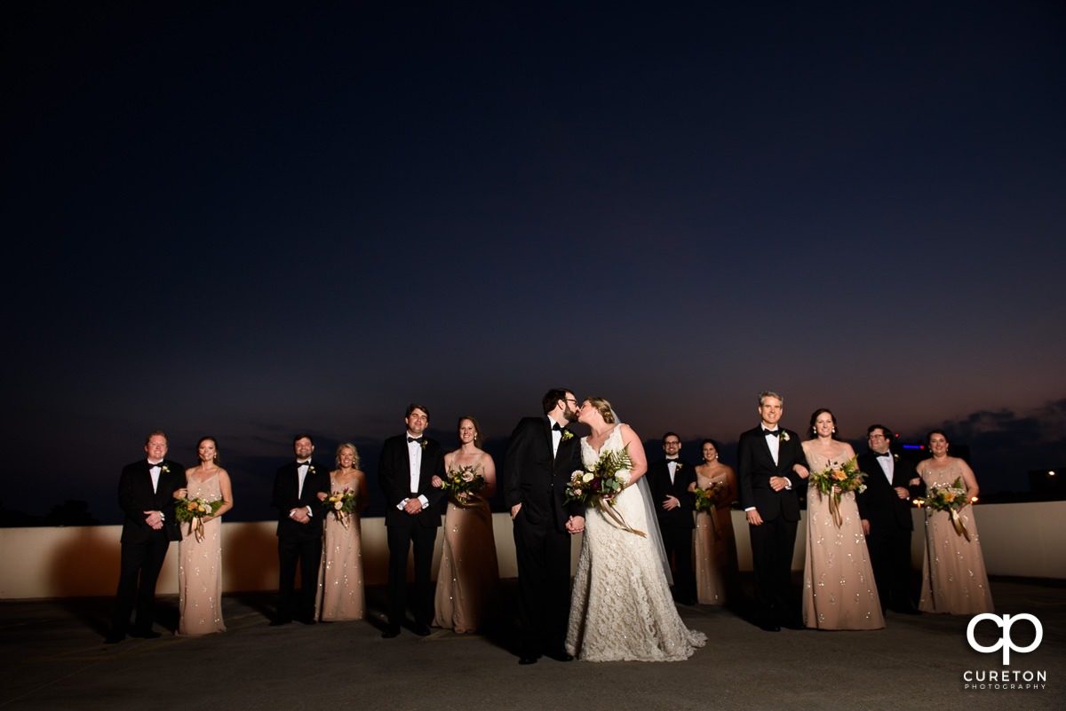 Bridesmaids and groomsmen on a rooftop in downtown Greenville,SC.