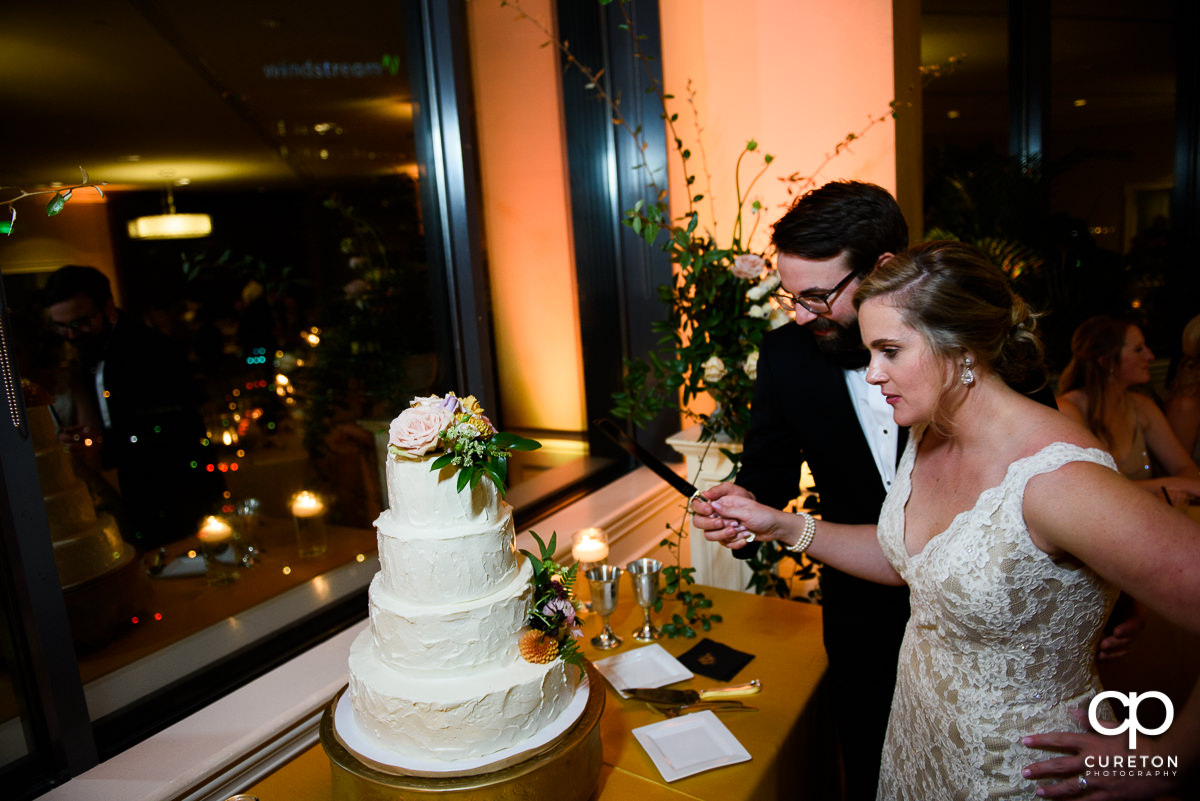 Bride and groom cutting the cake at the Commerce Club.