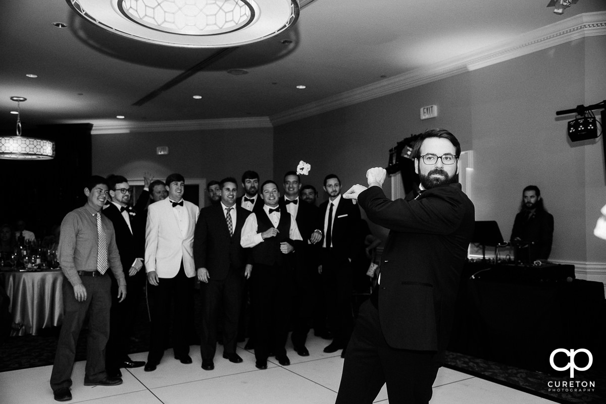 Groom throwing the garter.