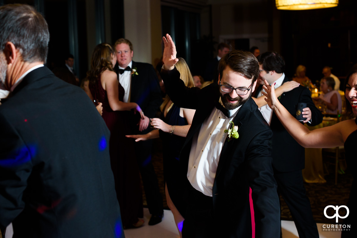 Wedding guests dancing on the dance floor at The Commerce Club.