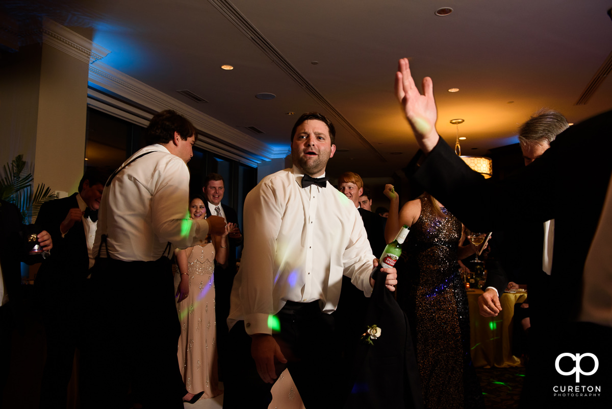 Wedding guests dancing at The Commerce Club reception.