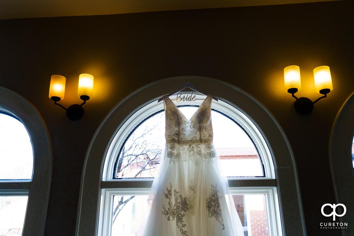 Bride's dress in beautiful window light.