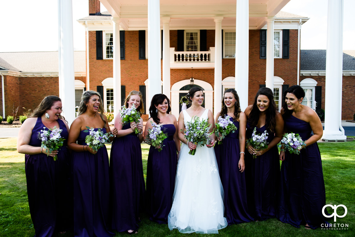 Bridesmaids laughing.