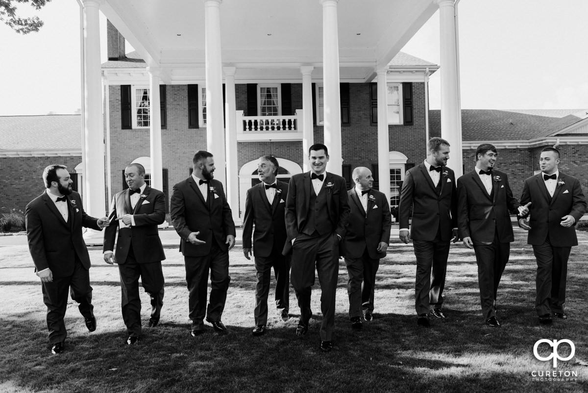Groom and groomsmen walking.