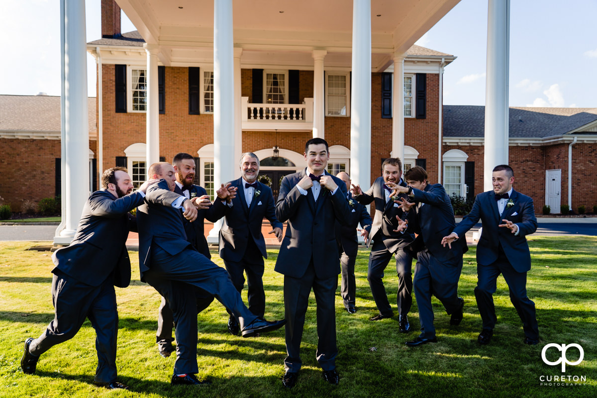 Groomsmen attacking the groom before the wedding.
