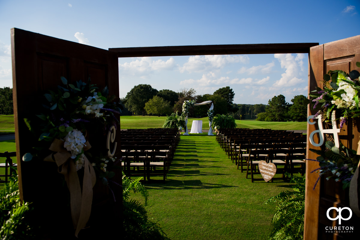 Wedding ceremony setup on the golf course at Holly Tree.