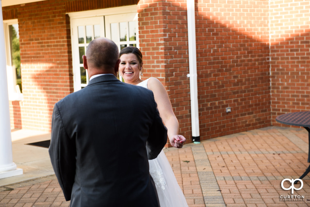 Bride's father seeing her in the dress for the first time.