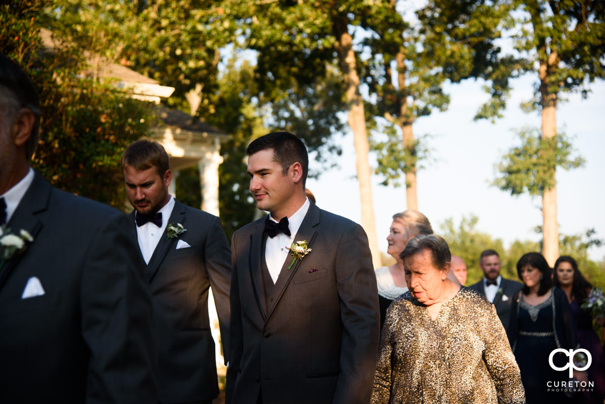 Groom walking to the ceremony.