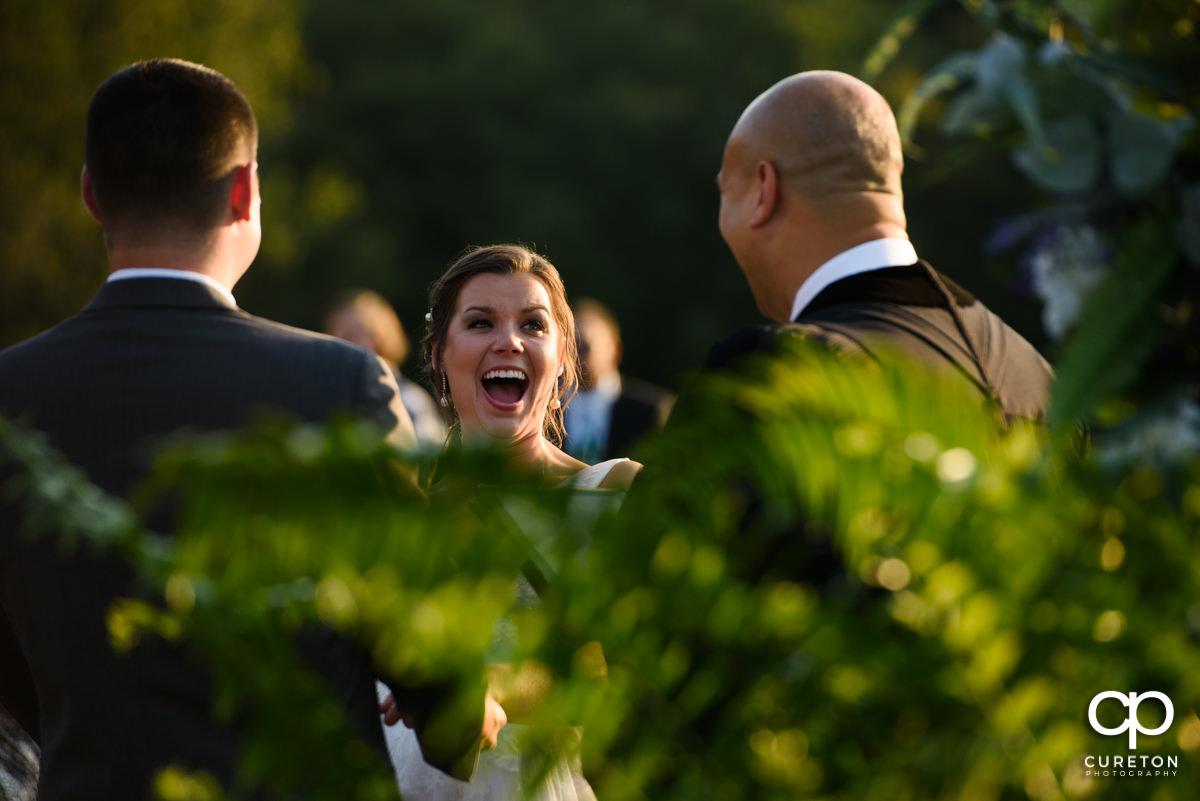 Bride laughing during her Holly Tree wedding.