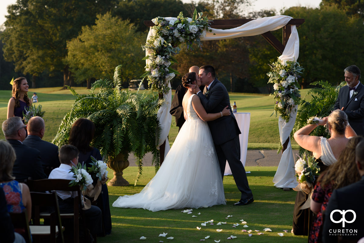 First kiss at the golf course wedding.