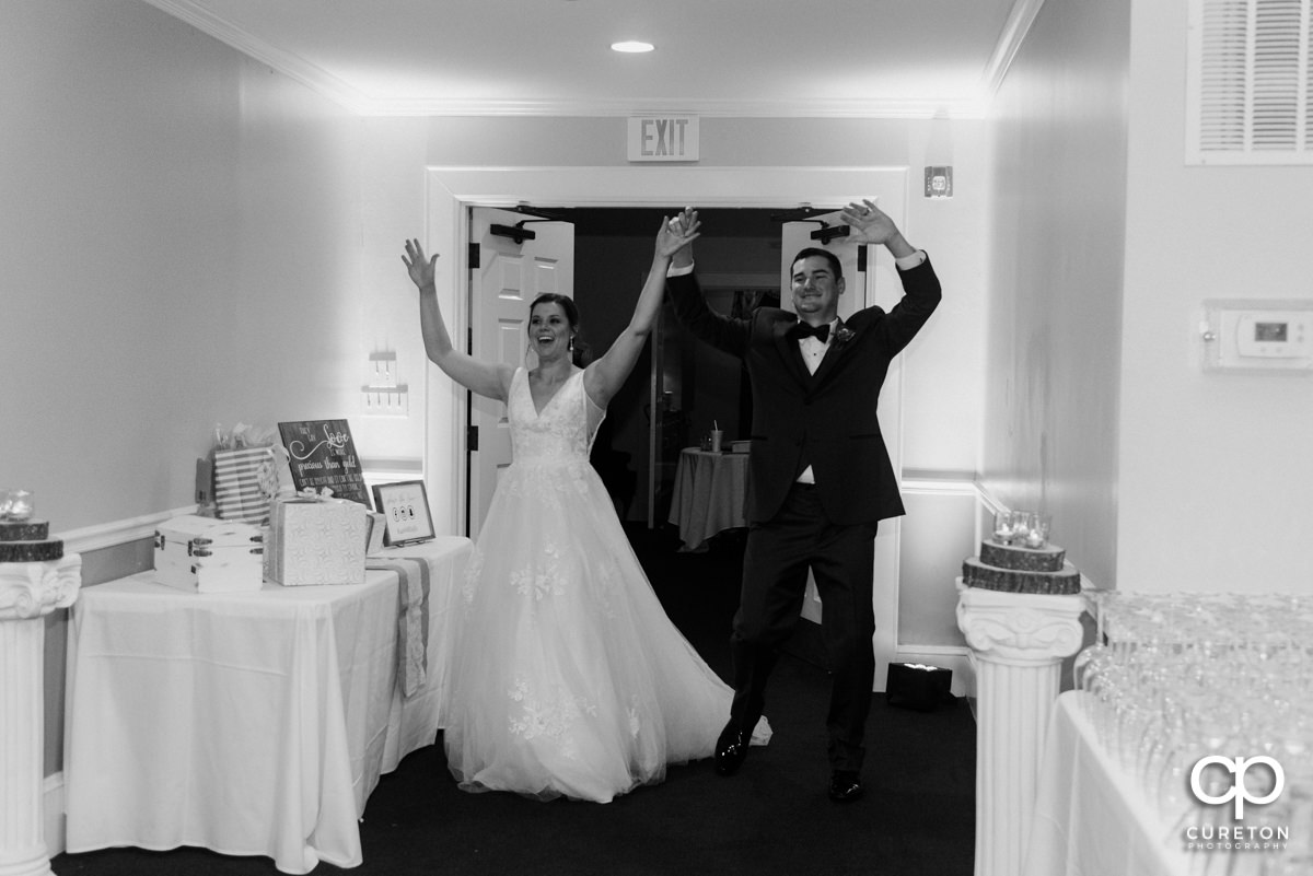 Newlyweds making an entrance into the reception.