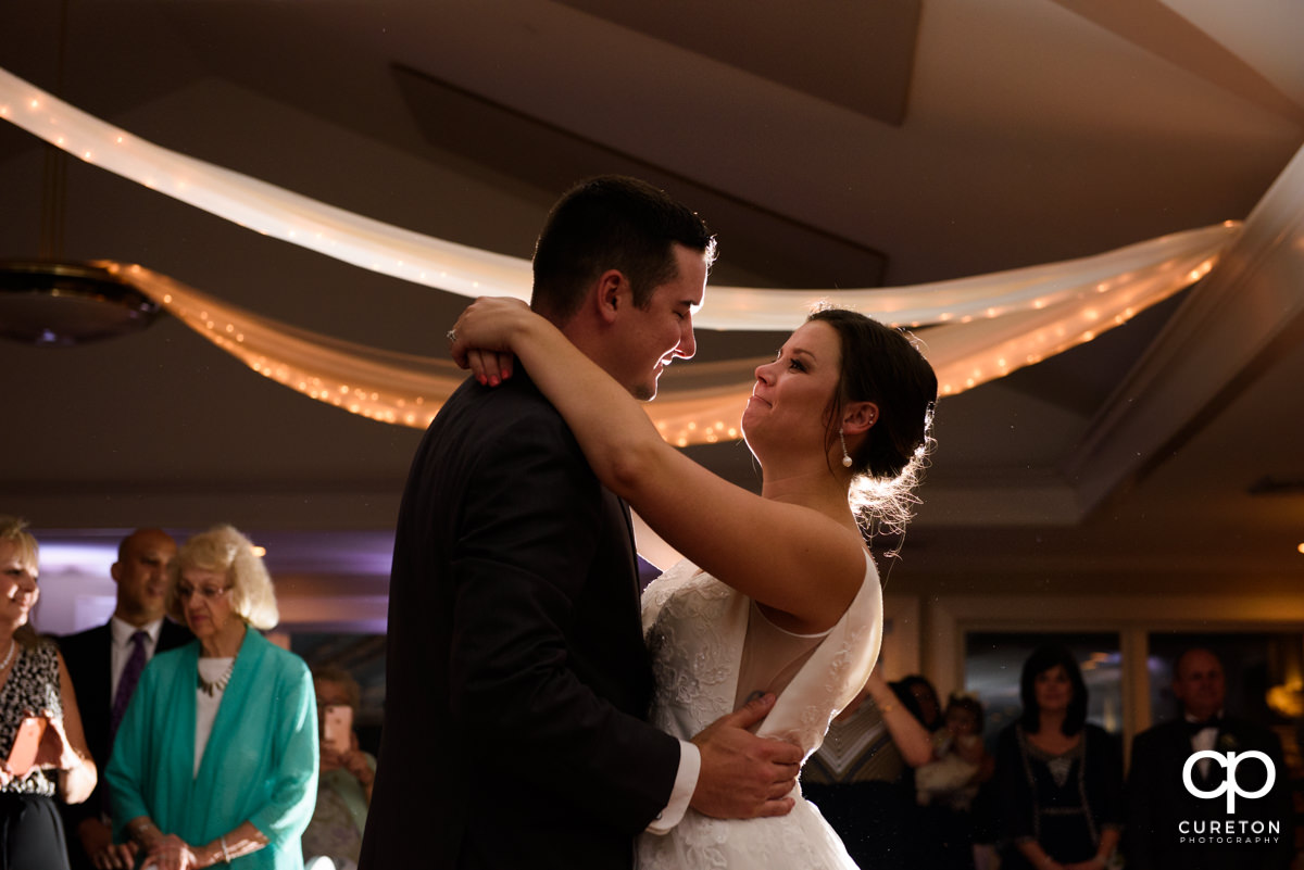 Bride and groom having their first dance at their Holly Tree Country Club wedding reception.