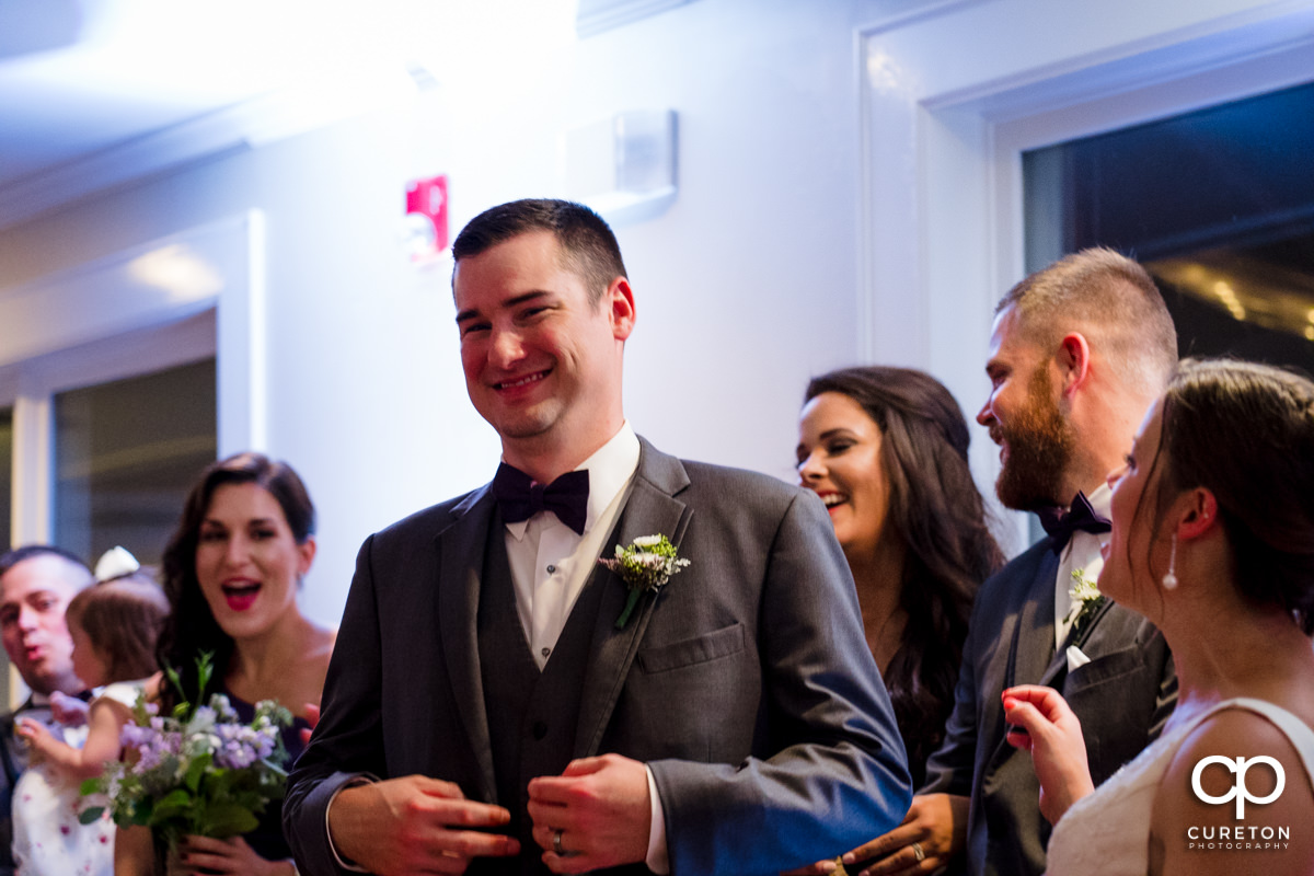 Groom smiling after the first dance at the reception.
