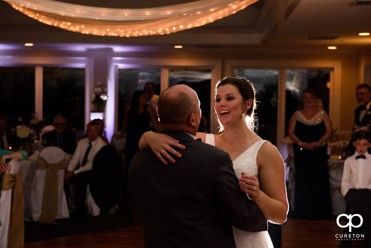 Bride dancing with her father at the wedding reception.