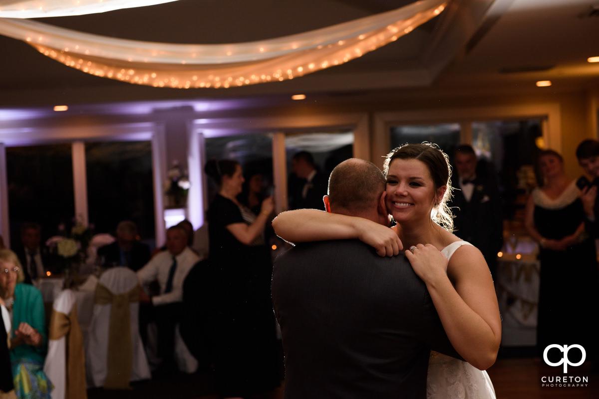 Bride hugging her dad at the wedding reception.