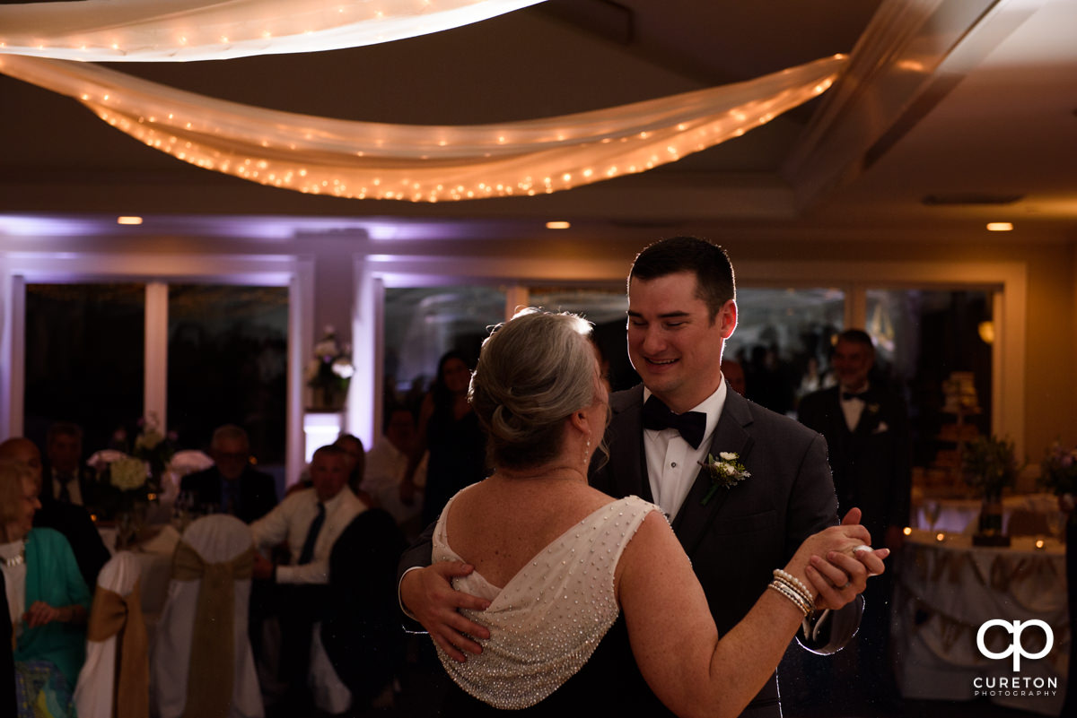 Groom dancing with his mother at the wedding reception.