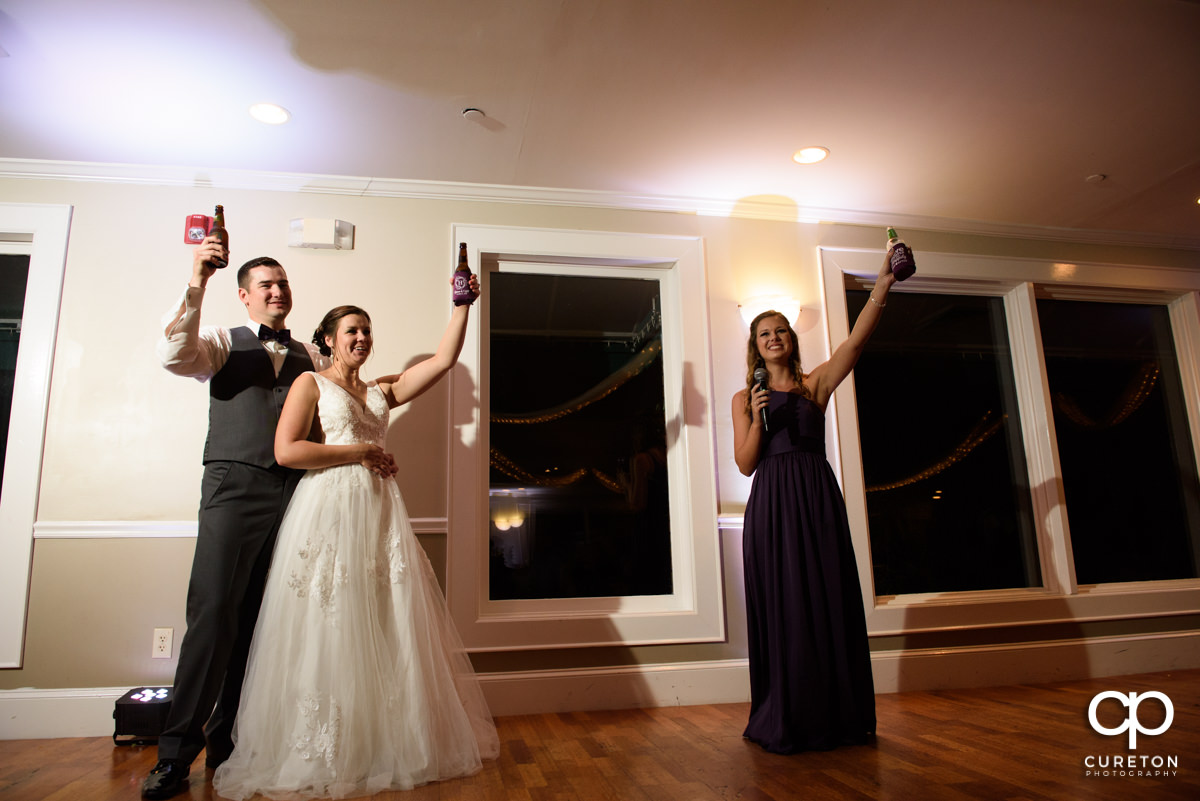 Bride's sister toasting the happy couple.
