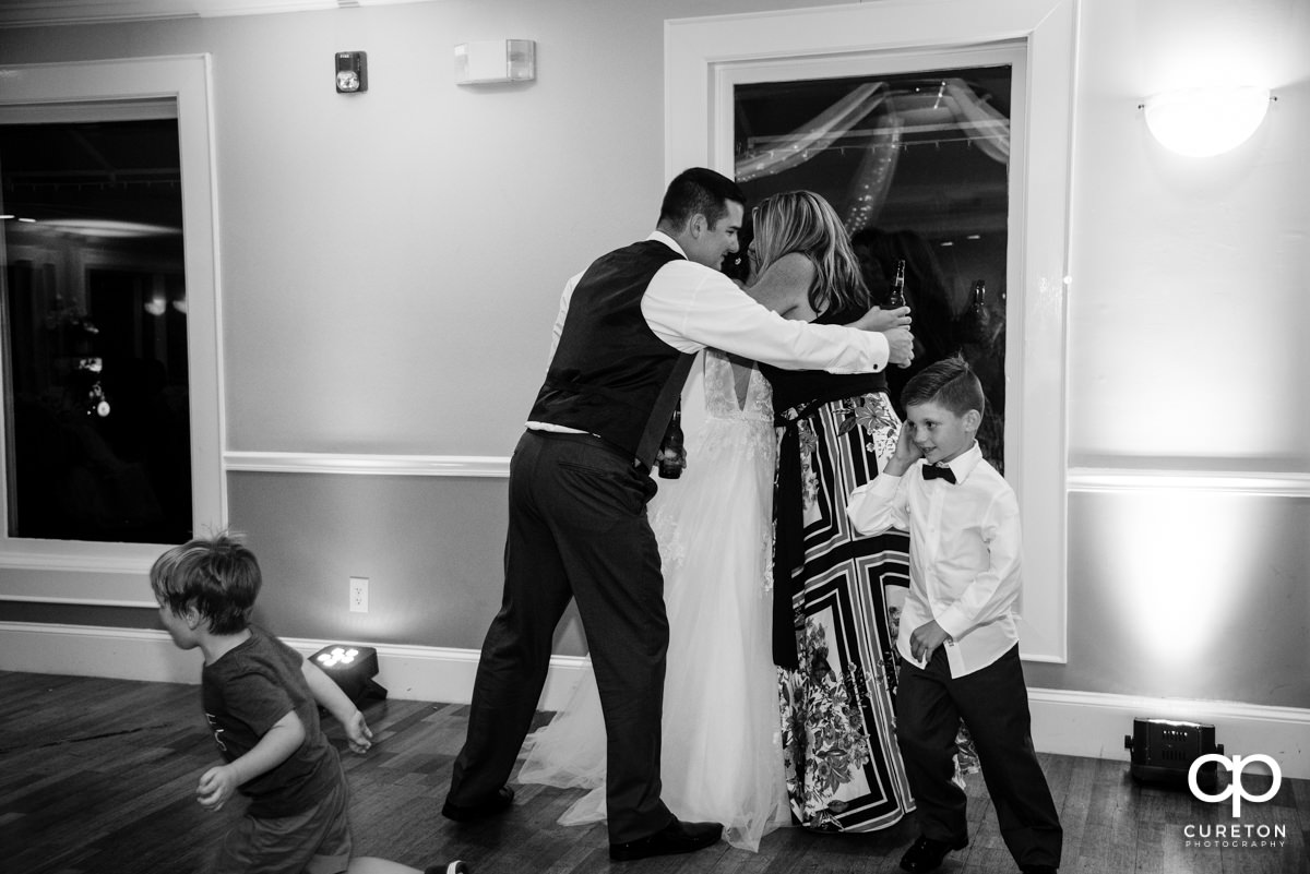 Wedding party members giving a speech.