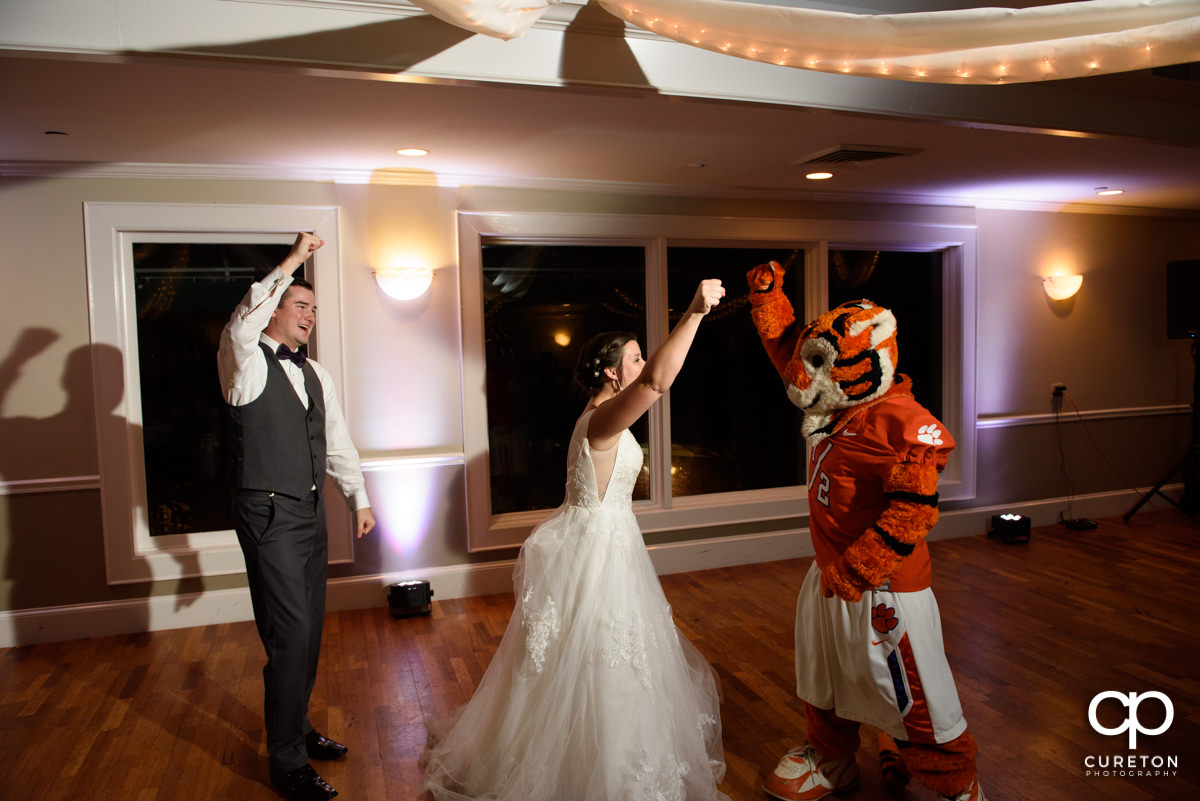 Bride and groom dancing with the Clemson Tiger.