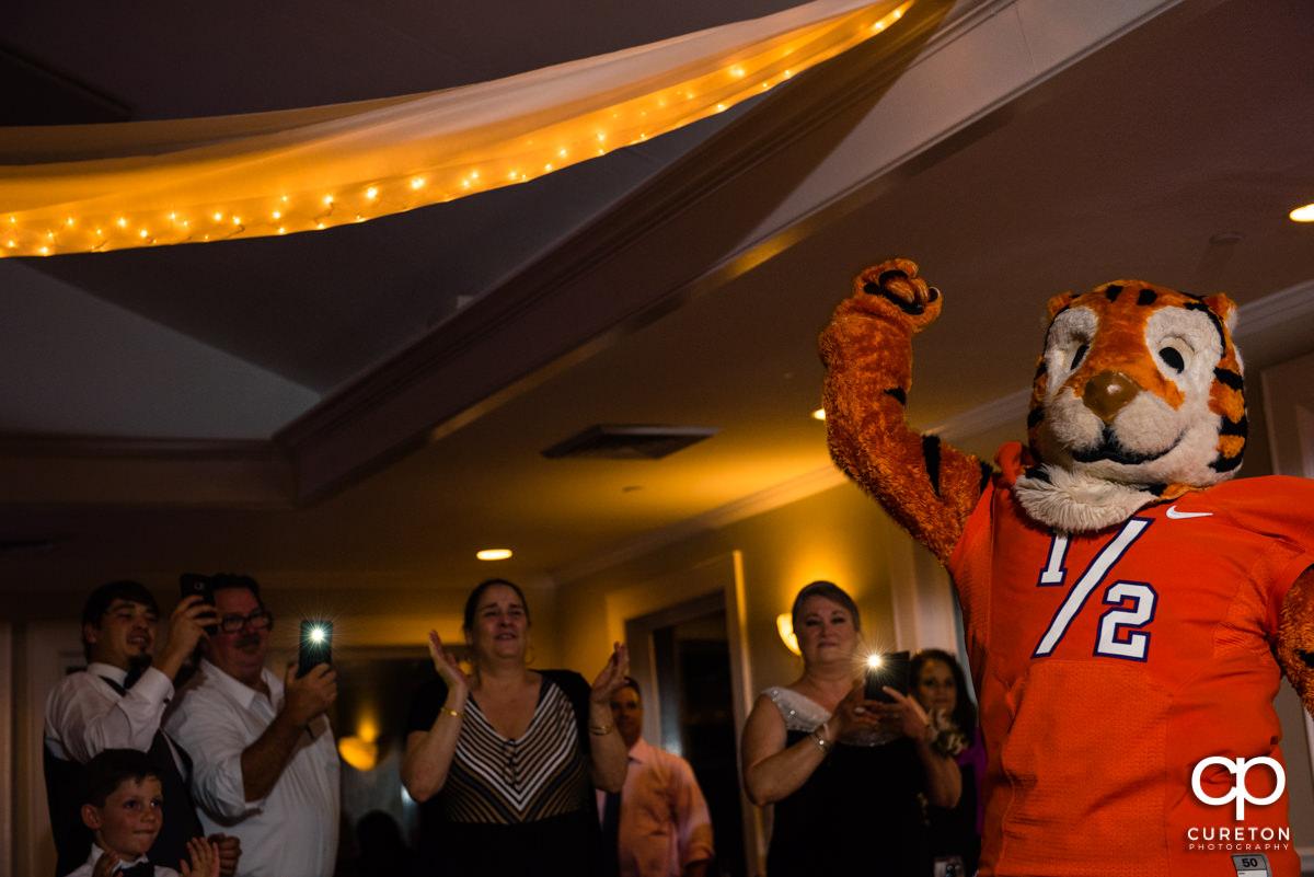 Clemson Tiger Cub cheering at the wedding reception.