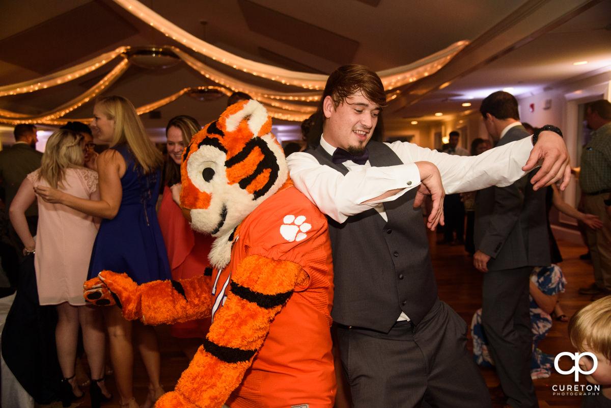 Clemson Tiger dancing at the wedding reception.