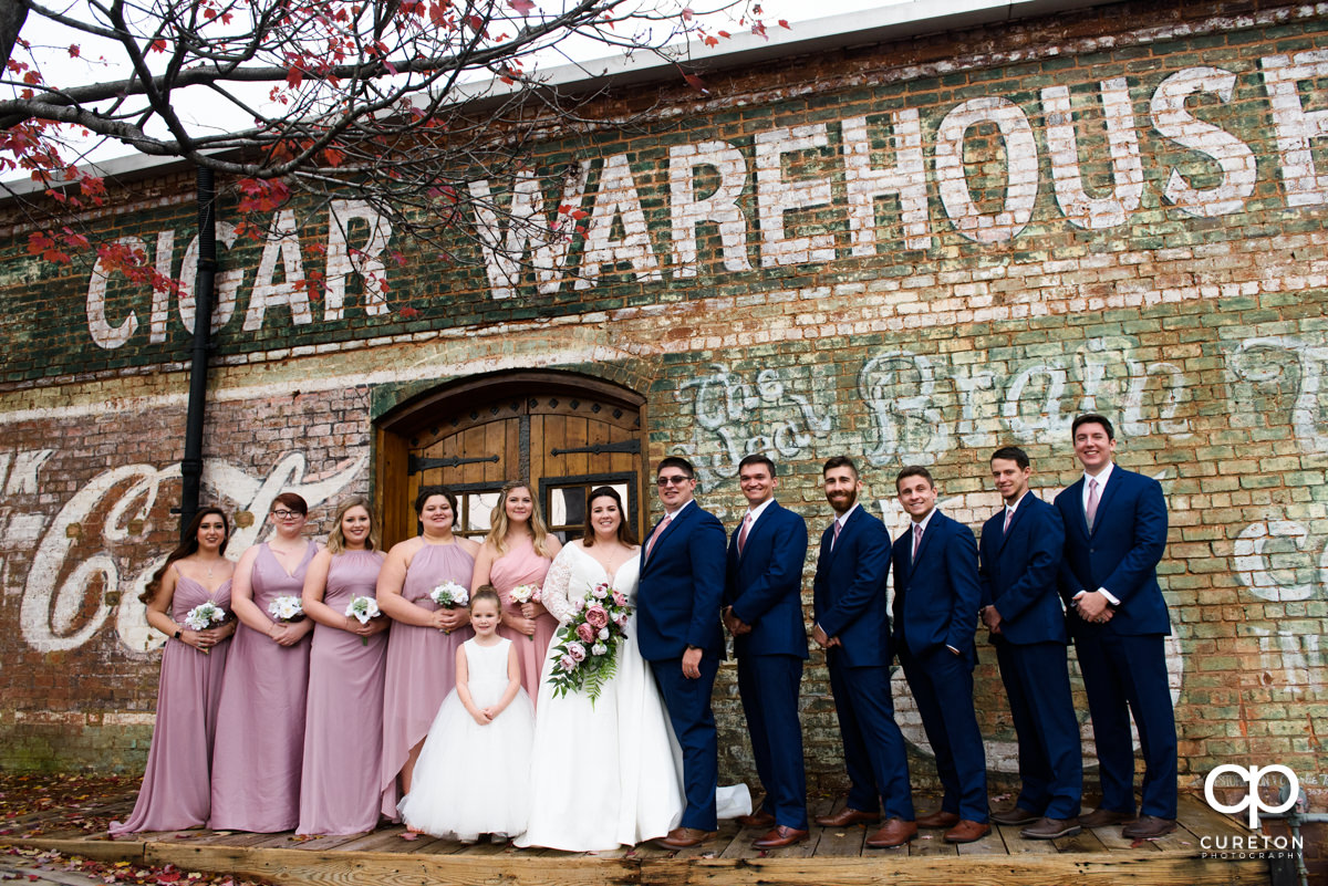 Wedding party standing on the back deck of the Old Cigar Warehouse after the ceremony.