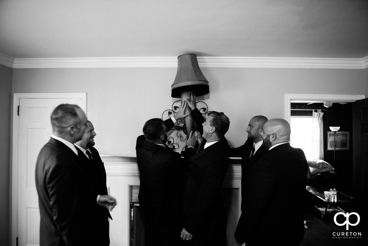 Groom and groomsmen looking at a leg lamp from A Christmas Story.