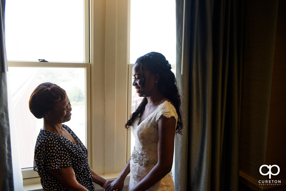 Bride and her mom have a moment before the wedding at The Westin Poinsett Hotel.