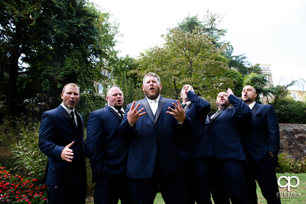 Groomsmen having fun at the Rock Quarry Garden.