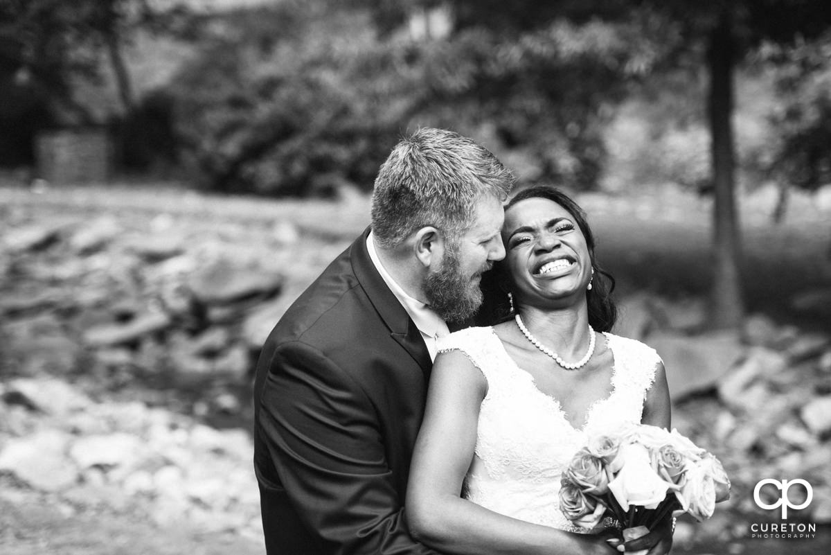 Groom making his bride laugh.