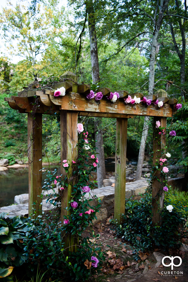 The floral arbor for their wedding at Falls Park.