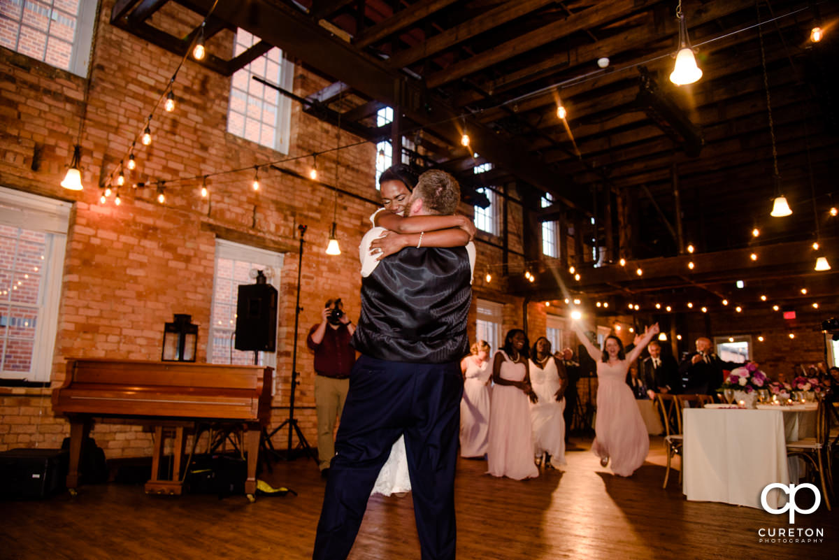 Bride and groom reenact the Dirty Dancing lift during their first dance.