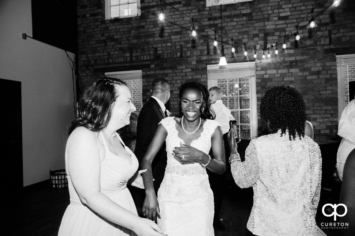Bride and her friends laughing at the reception.