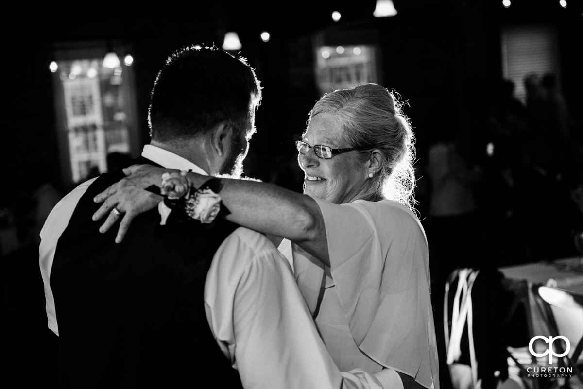 Groom dancing with his mother.