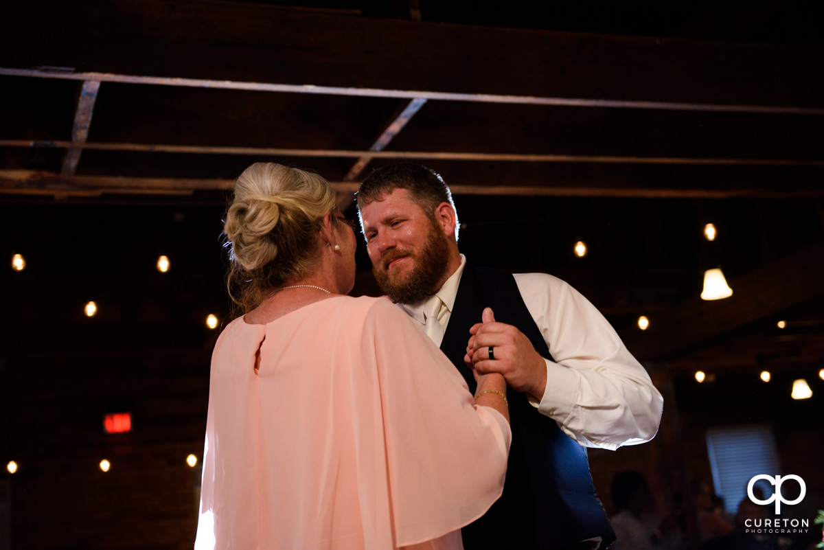 Groom dancing with his mom at the reception.