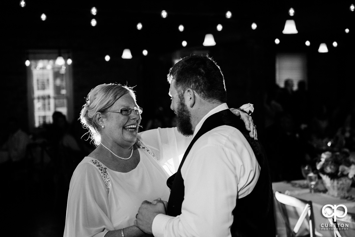 Groom and mom dancing.