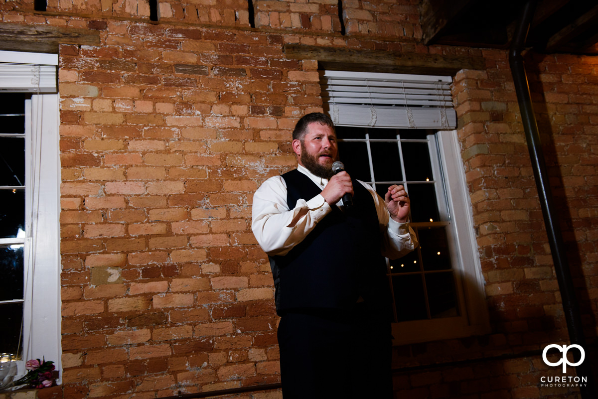 Groom giving a speech at his wedding.