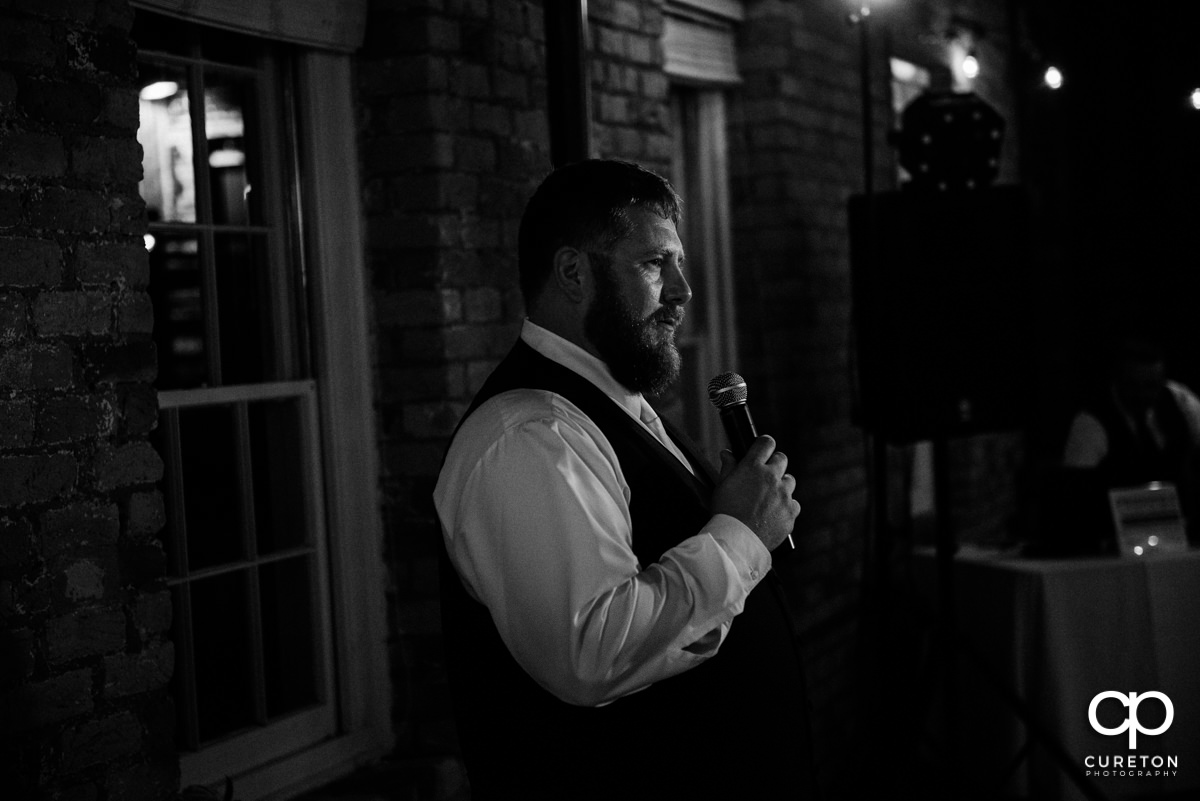 Groom welcoming the wedding guests.